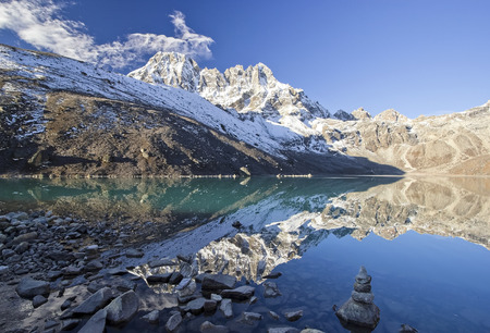 Mountains reflected in lake, Sagarmatha National Park, Himalayas  photo