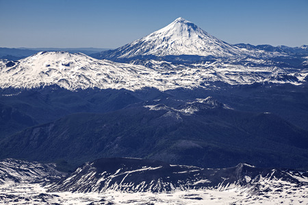 View of volcanos surrounding Villarica in Chile  photo