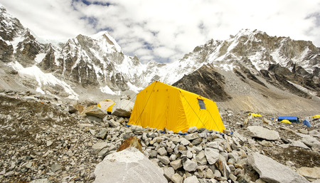 Tents in Everest Base Camp in cloudy day  Here starts the climb to reach the top of the highest mountain in the world, Everest Region, Sagarmatha National Park, Himalayas, Nepal   photo