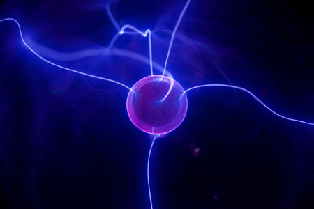 Pink plasma ball with blue blots, abstract background   photo
