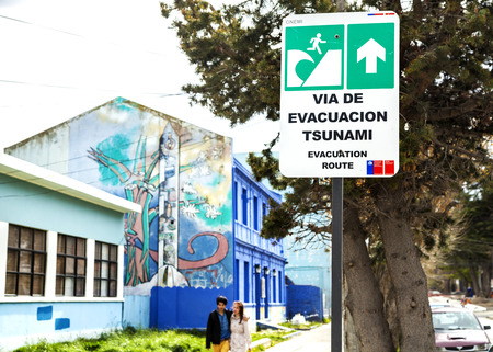 PUERTO MONTT, CHILE - October 25  Street sign showing evacuation way in case of tsunami, October 25, 2013 in Puerto Montt, Chile