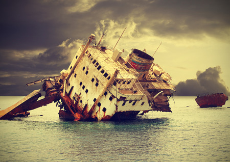 The sunken shipwreck on the reef, Egypt, vintage retro filtered   photo