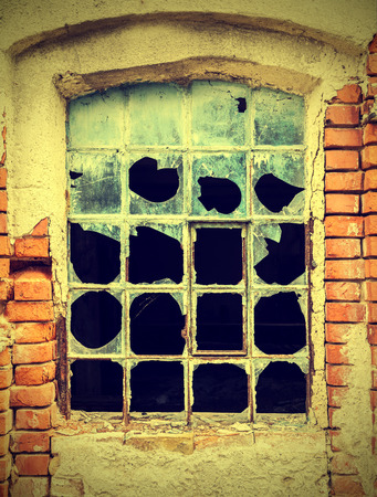 bleak: Dirty and broken glass, abandoned factory, vintage style.