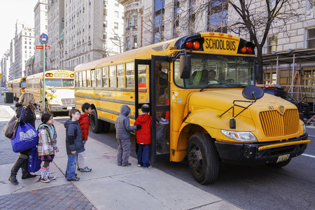 New York City, USA - March 03, 2011  Children entering school bus in the center of Vew Your City