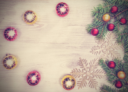 Vintage Christmas background, decoration on a wooden board. photo