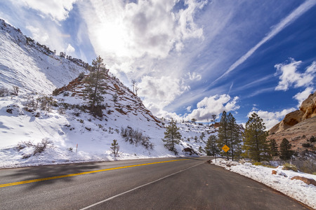 winter road: Sun above a mountain road in Zion National Park, Utah, USA