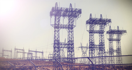 power cables: Vintage retro picture of pylons and transmission power lines.