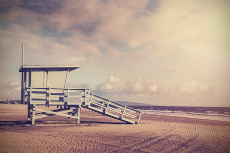 Vintage retro picture of wooden lifeguard tower, Beach in California, USA.