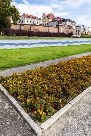 riverside: Flowerbed in Torun, Vistula riverside path, Poland. Stock Photo