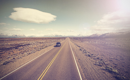 ruta: Vintage picture of car on endless country highway, Ruta 40 in Argentina.