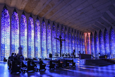bosco: Brasilia, Brazil - August 22, 2008: Interior of The Sanctuary of Dom Bosco filled with blue and pink windows that cover entire walls (2200 sq. m. in total).