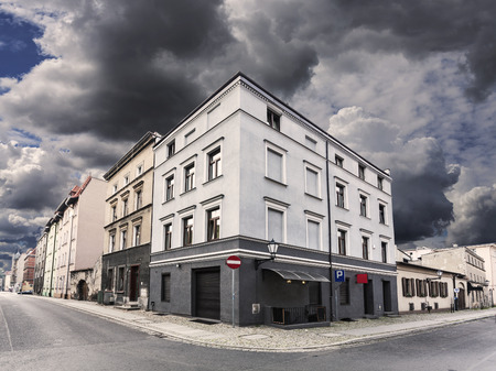 Rainy sky over street corner in Chelmno, Poland.
