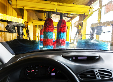 Car wash from inside a car during the wash. photo