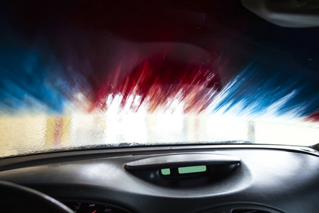 car service station: Motion blurred picture of car wash from inside a car during the wash.