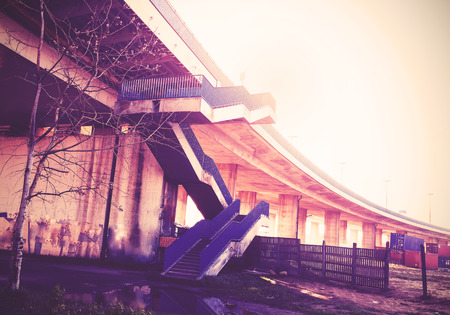 Vintage filtered picture of highway stairs and infrastructure. photo