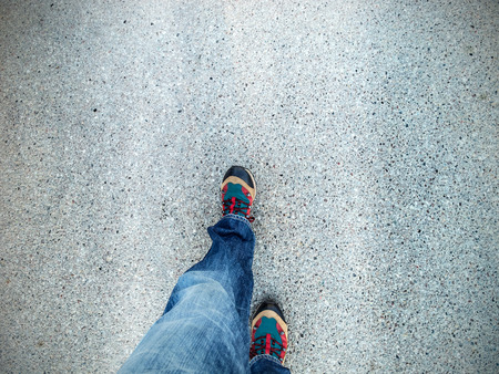 city road: Concept picture of legs walking on asphalt.