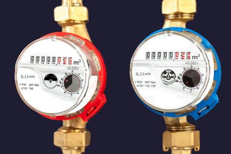 Water meters, sanitary equipment on dark background. Stock Photo