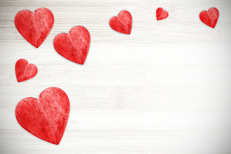 Red hearts on white timbered background, space for text. photo