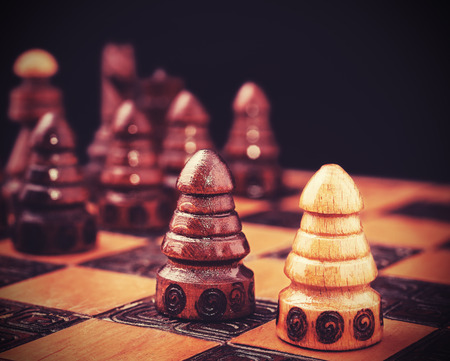 against all odds: Vintage filtered picture of chess, one against all concept.