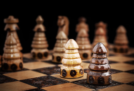 against all odds: Picture of a chess, one against all concept.