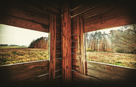 deer hunter: Retro filtered interior of hunting tower in autumn season.