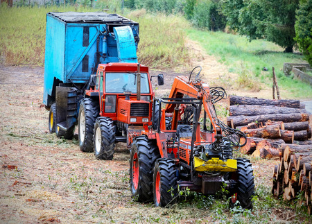 timber industry: Old tractor and equipment used in timber industry.