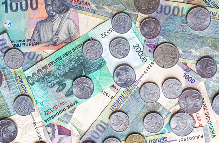 rupiah: Money from Indonesia, rupiah banknotes and coins.