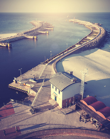 Vintage filtered picture of harbor in Kolobrzeg. photo