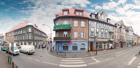 aleksander: Bialogard, Poland - November 27, 2014: Panoramic view of Wojska Polskiego Street in the city centre. Bialogard is a place of birth of Aleksander Kwasniewski, the President of Poland from 1995 to 2005.