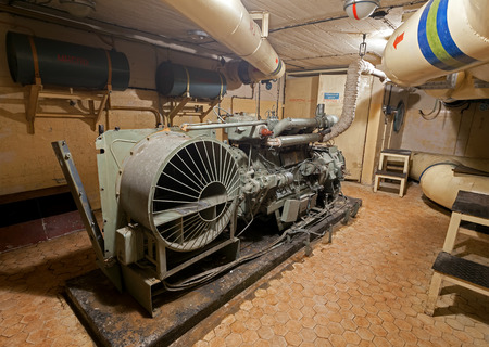 diesel generator: Podborsko, Poland - November 29, 2014: Diesel generator in Soviet nuclear weapon storage. During the Cold War, there of such a top secret facitities were located in Poland.