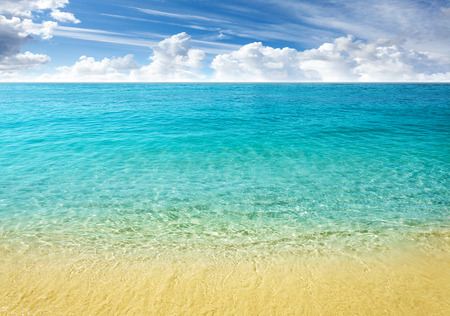 beach sun: Nature background, clear water and blue cloudy sky. Stock Photo