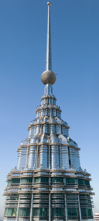 Kuala Lumpur, Malaysia - January 15, 2015: High quality picture of one of Petronas Twin Towers pinnacle. It features spire with 23 segments and a ring ball comprised of 14 rings of varying diameters.