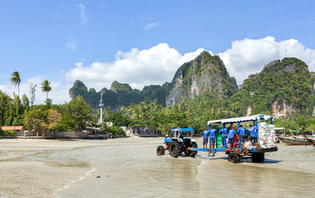 phuket food: Railay, Thailand - December 31, 2014: Food and staff transport from mainland by boats to Railay beach, one of the most popular rock climbing locations in Asia.