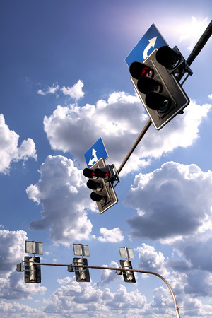 traffic light: Traffic lights against a vibrant blue sky with clouds.