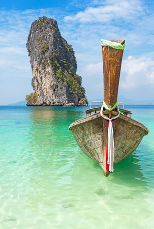 calm background: Old wooden boat on a tropical island.