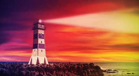 Seascape with lighthouse at sunset photo