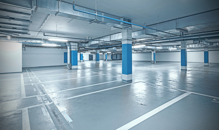 Cross processed photo of underground parking, industrial interior background. Standard-Bild
