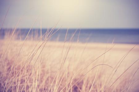 Blurred summer beach background in retro vintage style.