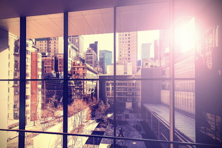 business building: Retro vintage stylized picture of Manhattan with flare effect, New York City, USA. Stock Photo