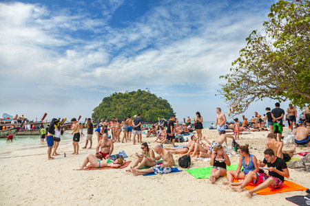 unsustainable: Tup Island, Thailand - January 05, 2015: Small island crowded with tourists. Picture presents unsustainable and unregulated tourism development by small private companies in Thailand.