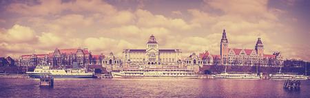 agglomeration: Retro old film stylized panoramic view of Szczecin waterfront, Poland.