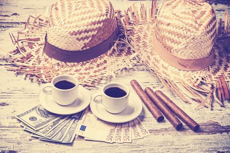 coffees: Vintage filtered coffees, cigars, money and hats. Summer adventure concept. Stock Photo