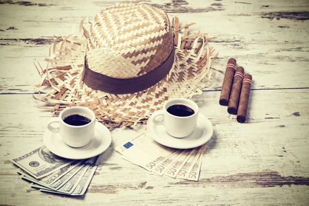 coffees: Retro filtered coffees, cigars, money and hats. Summer adventure concept.
