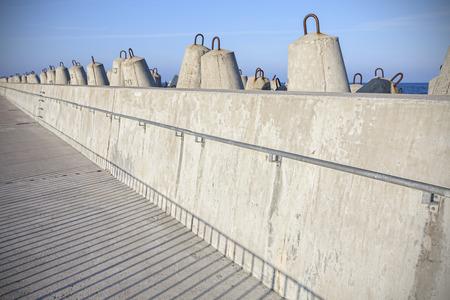 breakwaters: Sea pier and concrete block breakwaters in Kolobrzeg, Poland.