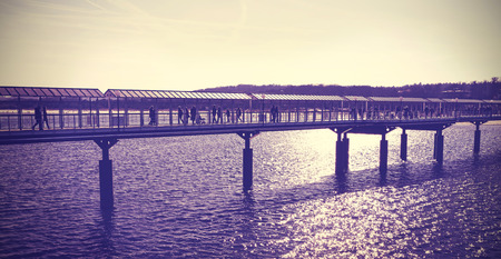 against the sun: Vintage toned pier against sun, Heringsdorf in Germany.