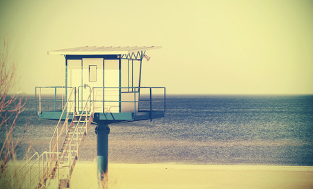 cross process: Retro cross process style filtered picture of a lifeguard tower on a beach. Stock Photo