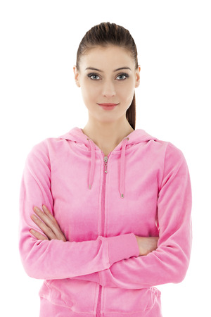 Portrait of a young beautiful smiling woman in pink tracksuit, isolated on white. Stock Photo