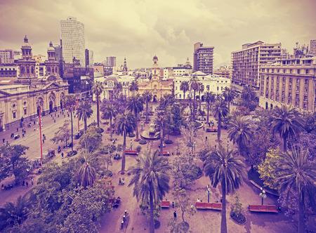 Vintage stylized photo of Santiago de Chile downtown Plaza de Armas where modern skyscrapers mix with historic buildings Chile. photo