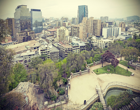 Retro stylized photo of Santiago de Chile downtown Modern skyscrapers mixed with historic buildings Chile. photo