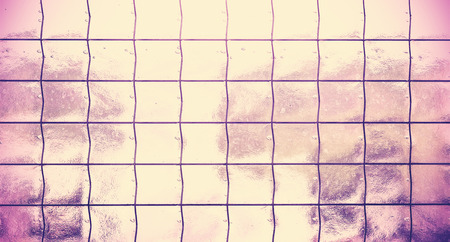 grating: Vintage style abstract background made of translucent glass with grating.